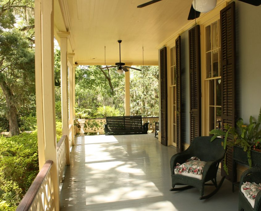 front porch with furniture on a sunny day - mortgage broker - real estate loans