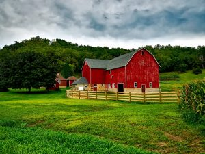 Red barn with fence in Wisconsin - Farm Loans - Rehab Loans