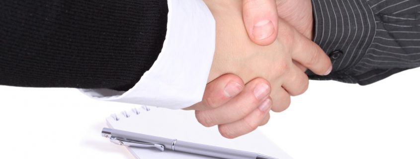 Shaking hands over contract - Mortgage Broker vs Bank